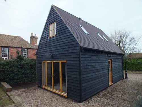 Smart looking barn painted in a dark grey with a semi gloss finish achieved with carbolustre 2000 barn paint