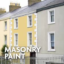 Mews row of properties with painted masonry in grey and yellow