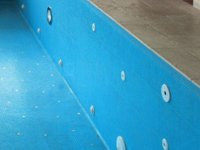 blue interior of a swimming pool to illustrate chlorinated rubber paint