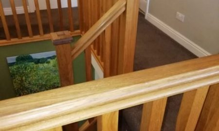 Gold colour oak stair case treated with danish oil