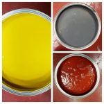Three open tins of floor paint yellow, grey and red