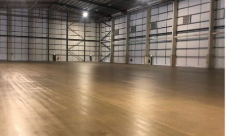 Vast concrete floor in warehouse, sealed with shiny concrete sealer