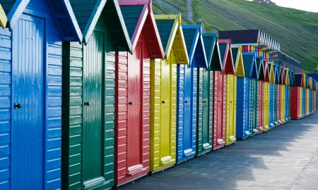 Row of beach huts in bright primary colours