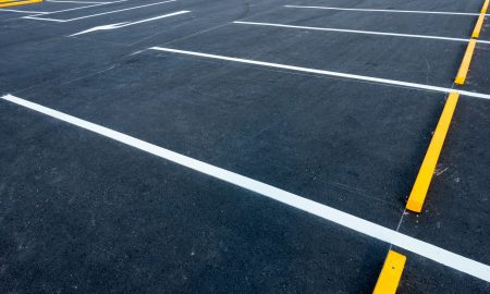Black tarmac with white line painted parking spaces