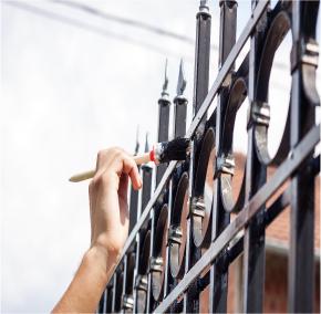 hand painting black metal railings